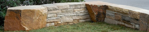Dry laid wall with Colorado buff sandstone with boulders