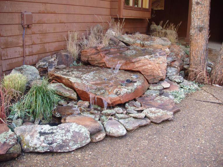 Lichen covered sandstone water feature