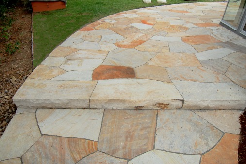 Dry laid patio and step built with Colorado buff sandstone - photo Russ Croop